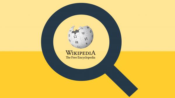 Förstoringsglas över Wikipedias logga